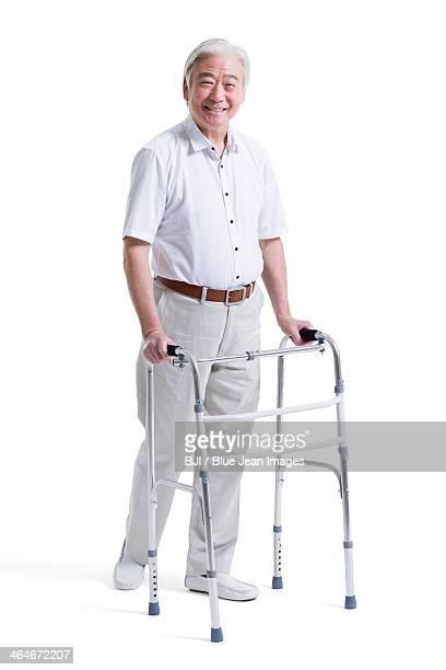 Happy senior man with walker
