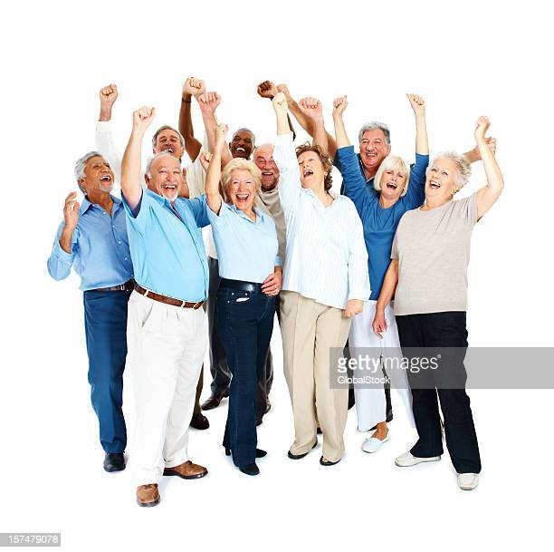 Happy senior men and women with arms raised