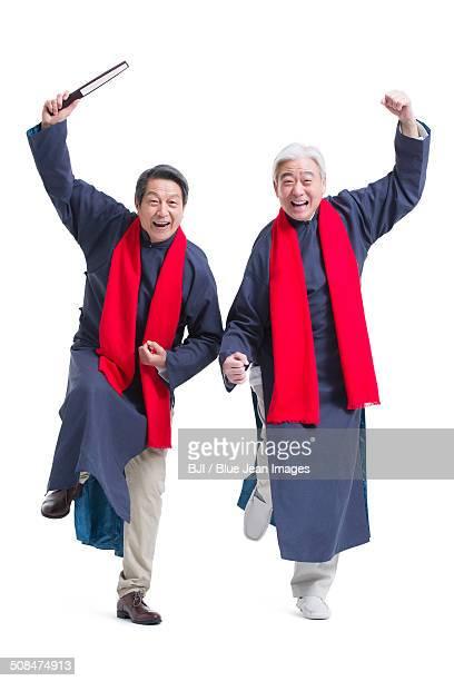 Happy senior men celebrating Chinese New Year