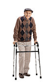 Full length portrait of a happy senior using a walker isolated on white background