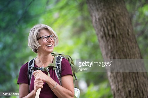 Happy Senior Woman Backpacking : Stock Photo