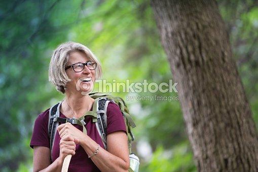 Happy Senior Woman Backpacking : Stock Photo
