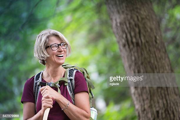 Happy Senior Woman Backpacking