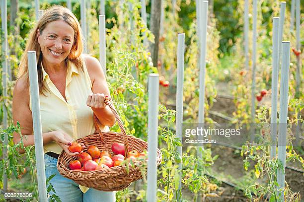 Happy Senior Woman in her Vegetable Garden