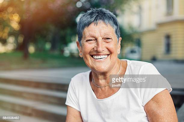 Happy senior woman in summer