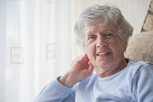 Happy senior woman indoors smiling in her house