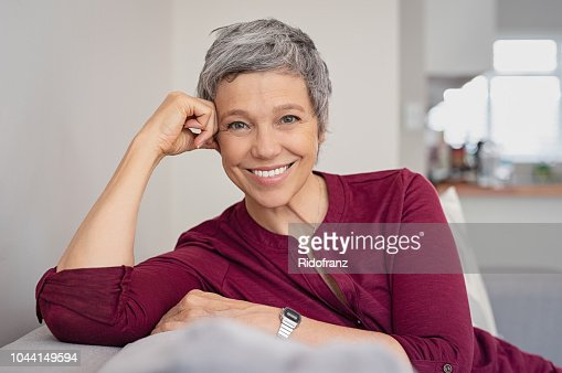 Happy senior woman on couch : Foto stock