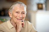 Portrait of happy senior woman. Close-up, shallow DOF.