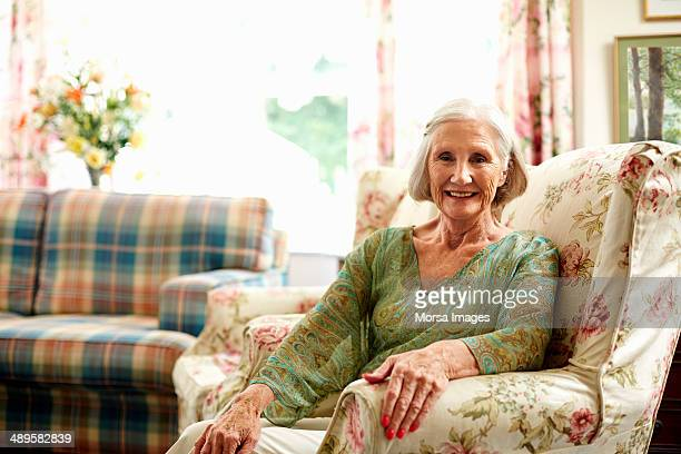 Happy senior woman relaxing on armchair