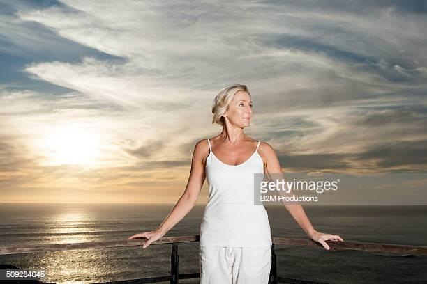 Happy Senior Woman Standing In Balcony