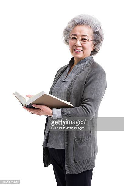 Happy senior woman with book