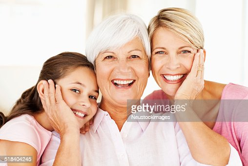 Happy Senior Woman With Grandchild And Daughter At Home