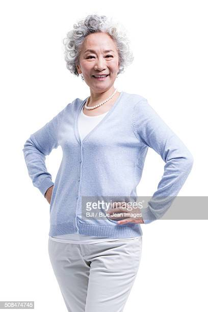 Happy senior woman with hands on hip