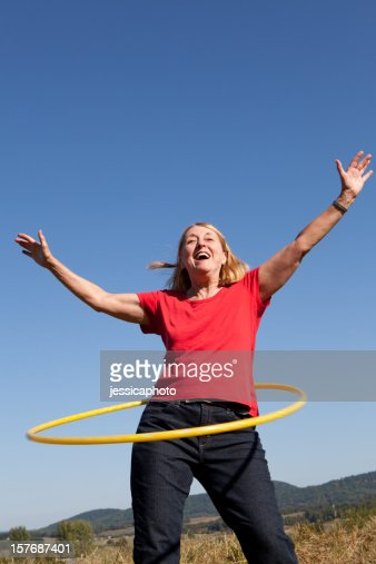 Happy Senior Woman with Hoop. Exercise.