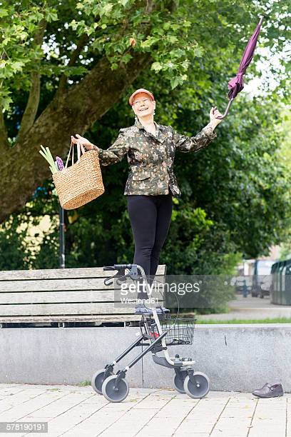 Happy senior woman with wheeled walker