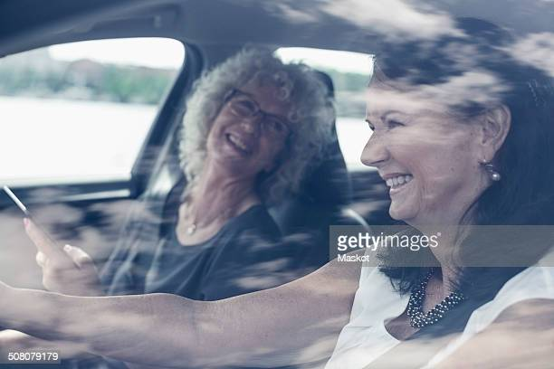 Happy senior women enjoying road trip