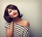 Happy short hair makeup woman thinking and looking up in modern blouse. Vintage closeup portrait