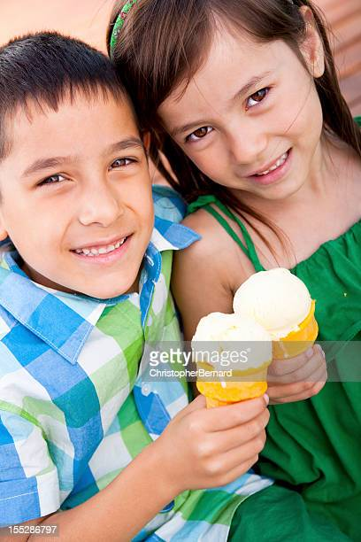 Happy sibling eating icecream