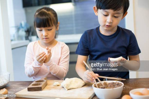Happy siblings baking together