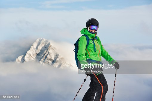 Happy skier on top of mountain