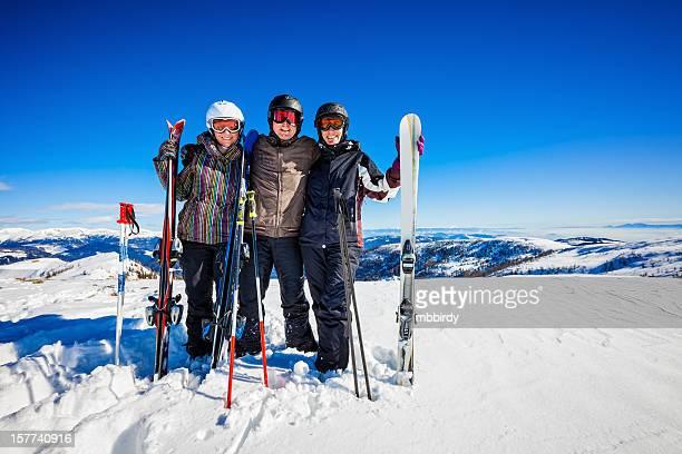 Happy skiers on top of ski resort