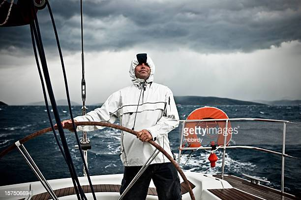 Happy skipper driving sailboat