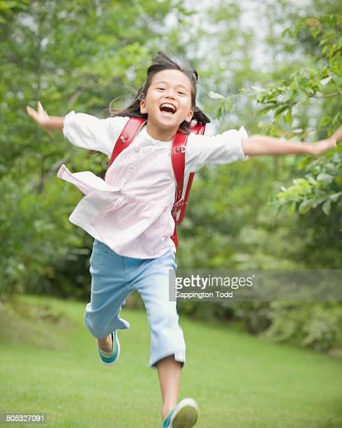Happy Small Girl Running