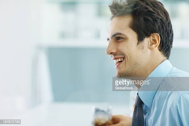 Happy smart business man sitting at a bar
