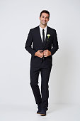 Happy smart groom in black suit, portrait