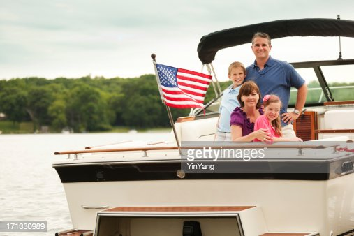 Happy, Smiling American Family Boating on Midwest Lake with Motorboat