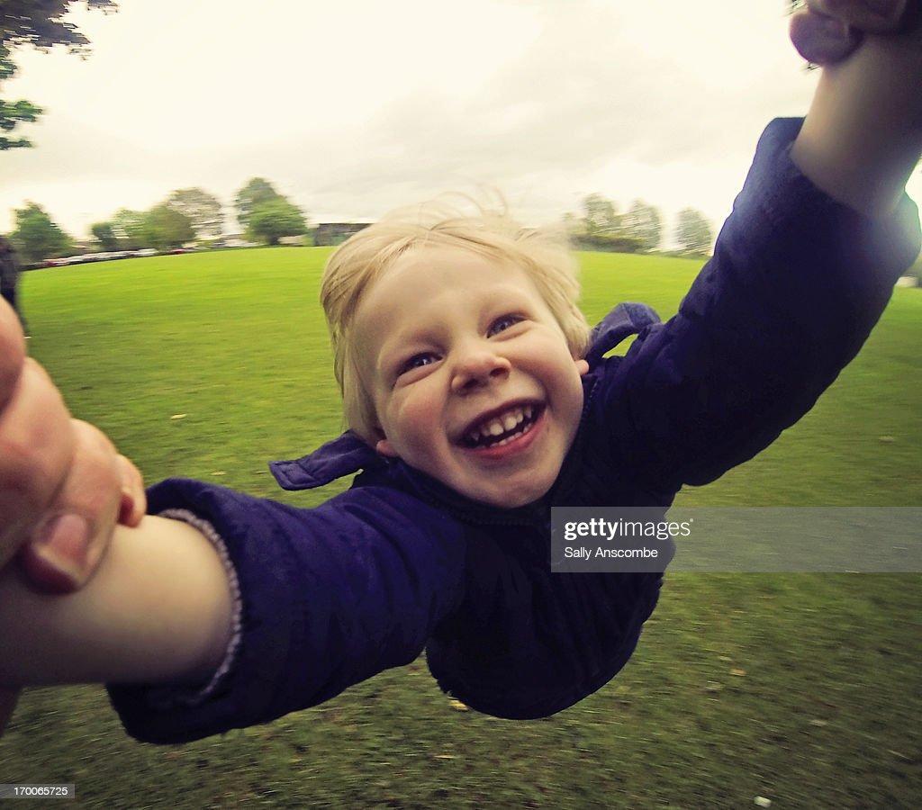 Happy smiling child having fun in the park : Stock Photo