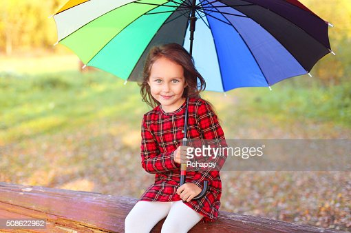 Happy smiling child with colorful umbrella in autumn day : Stock Photo