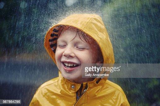 Happy smiling little boy in the rain : Stock Photo