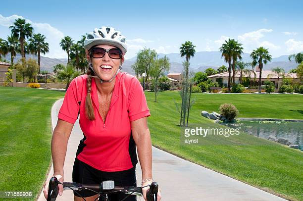 Happy Smiling Mature Woman On Her Bike