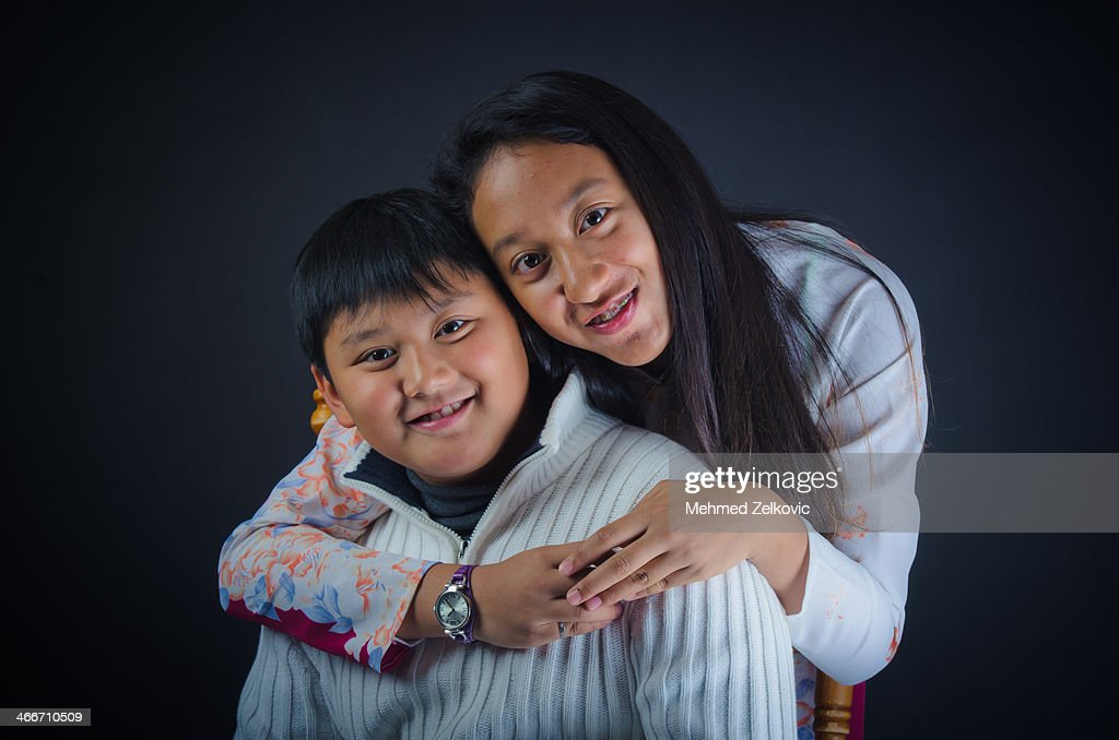Happy smiling Vietnamese brother and sister : Stock Photo