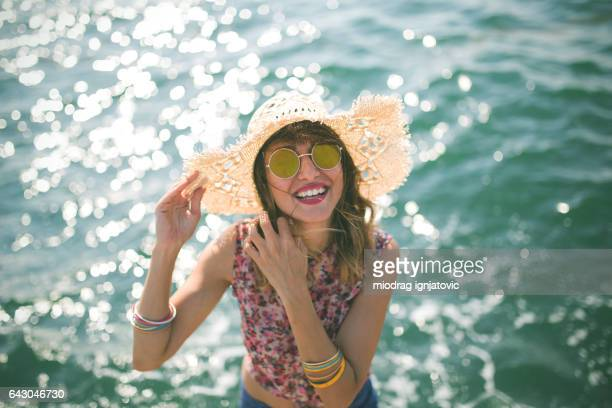 Happy smiling woman by the sea