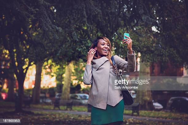 Happy smiling woman using a smart phone