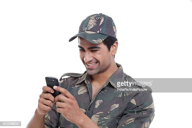 Happy soldier text messaging