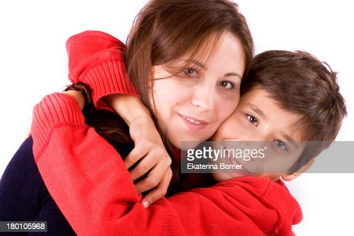 Happy son hugging his mother : Stock Photo