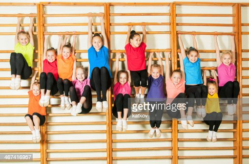 Happy sporty children in gym : Stock Photo
