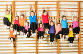 Group of happy sporty kids in gym