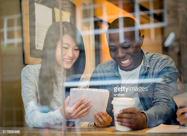 Happy students at a cafe