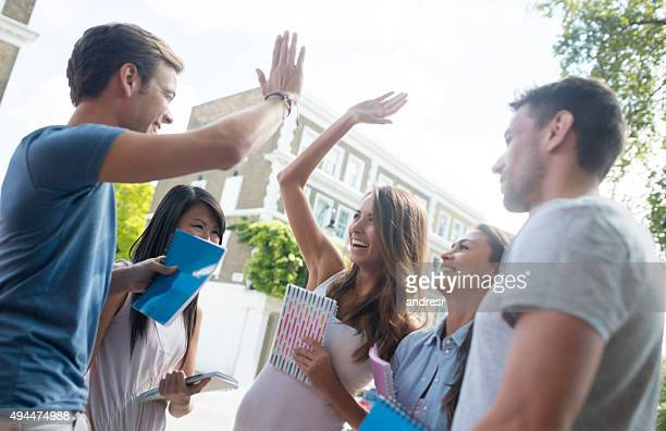 Happy students giving a high-five