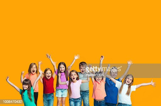 Happy success teensl celebrating being a winner. Dynamic energetic image of happy children : Foto stock