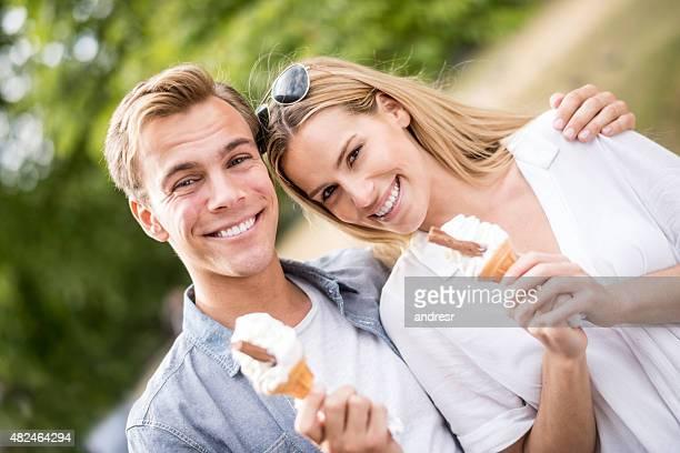 Happy summer couple eating ice cream