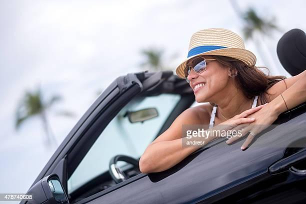 Happy summer woman renting a car