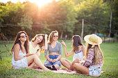 Happy female friends having fun outside in nature