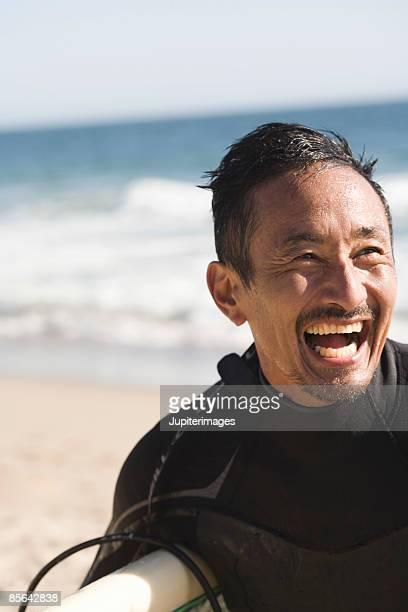 Happy surfer at beach