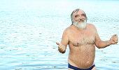 senior man swimming and having fun