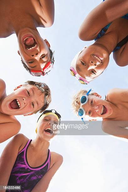 Happy swimmers in a huddle